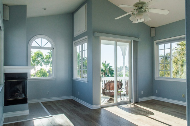 trendy-modern-interior-living-room-with-blue-walls-white-windows_181624-18642